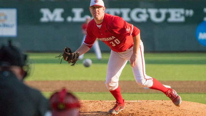 UL's Hogan Harris throws a pitch as the Ragin' Cajuns take on the ULM Warhawks on May 18, 2018 at M.L. Tigue Moore Field.