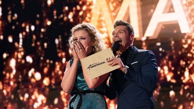 """Maddie Poppe, left, reacts with Ryan Seacrest after being announced the winner of """"American Idol"""" in Los Angeles on Monday, May 21, 2018, in Los Angeles, in this photo provided by ABC. The Iowa singer-songwriter bested Caleb Lee Hutchinson and Gabby Barrett in the two-hour finale on ABC."""