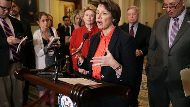 Sen. Amy Klobuchar (D-MN) (C) talks to reporters with Sen. Debbie Stabenow (D-MI) and Senate Minority Leader Charles Schumer (D-NY) (R) following the weekly Senate Republican policy luncheon at the U.S. Capitol May 22, 2018 in Washington, DC. Senate Republicans and Democrats said are close to advancing legislation that would reform the reporting process for victims of sexual harassment and would make members of Congress personally liable for any settlements.