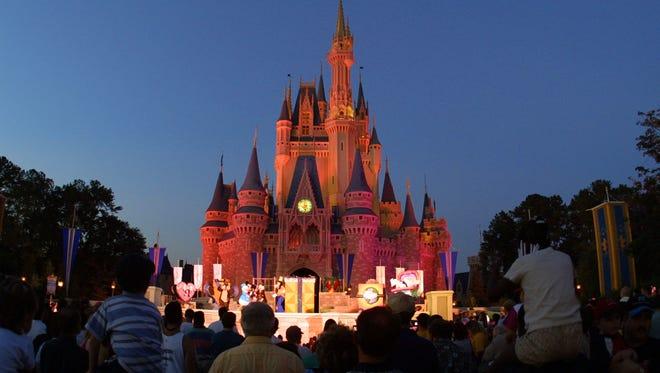Cinderella's castle at Walt Disney World's Magic Kingdom lights up at night.