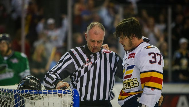 Colorado Eagles player Gabriel Verpaelst checks with an official if he is OK following an incident during Friday's Kelly Cup Finals against Florida.