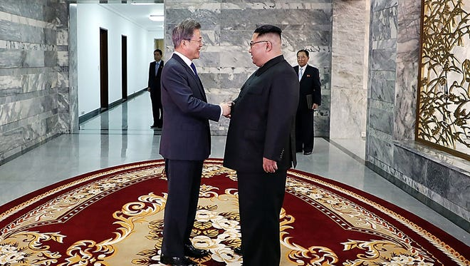 n this handout image provided by South Korean Presidential Blue House, South Korean President Moon Jae-in (L) shake hands with North Korean leader Kim Jong Un (R) before their meeting on May 26, 2018 in Panmunjom, North Korea. North and South Korean leaders hold the surprise second summit, after U.S. President Donald Trump once cancelled the meeting with Kim Jong-un scheduled on June 12, though Mr. Trump indicated that the meeting could take place a day after.