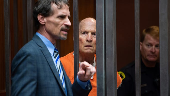 Joseph James DeAngelo stands with his attorney Joe Cress in a Sacramento, Calif. jail court on May 29, 2018, as a judge weighed how much information to release about the arrest of the former police officer accused of being the Golden State Killer. DeAngelo is suspected in at least a dozen killings, including those of Lyman and Charlene Smith in Ventura.