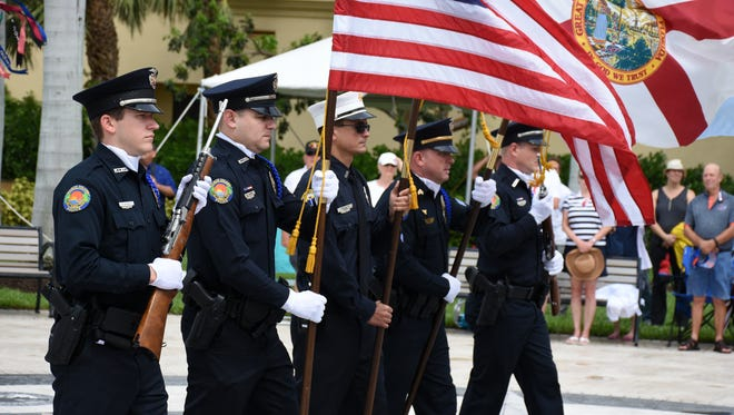An MIPD honor guard presents the Colors. The VFW hosted the Memorial Day observances 11 a.m. Monday at Veterans' Community Park on a windblown Marco Island.