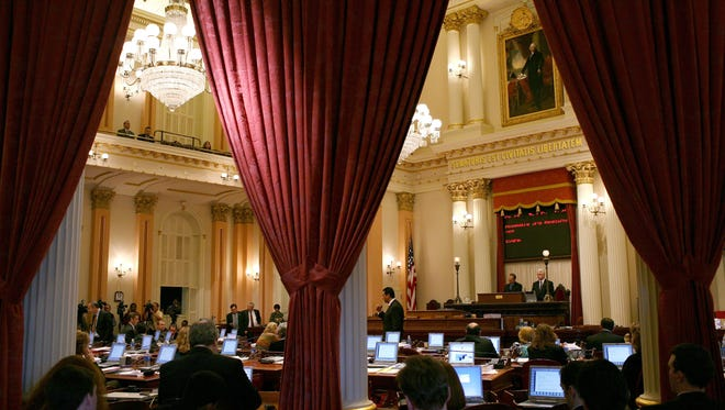 FILE - California State Senators speak during a session of the California State Senate February 17, 2009 in Sacramento, California.