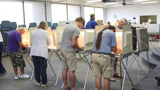 A group of people vote at the Center for Spiritual Living in Palm Springs, June 5, 2018.