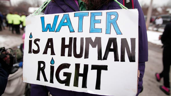 Protesters march in Flint, Michigan, in 2016 to draw