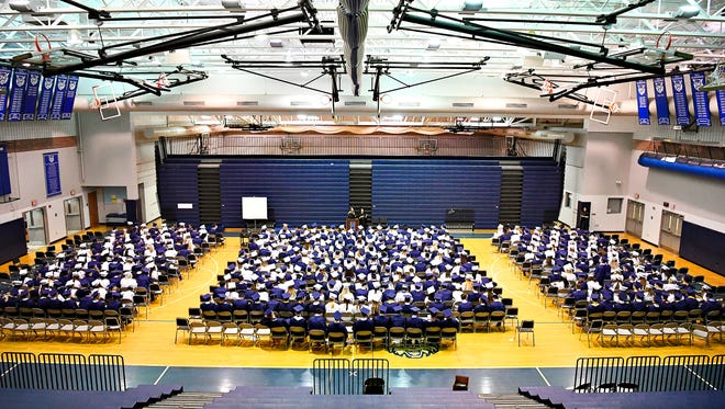 Graduates gather in the gymnasium before the Dallastown Area High School commencement ceremony at the school in York Township, Friday, June 8, 2018. Dawn J. Sagert photo