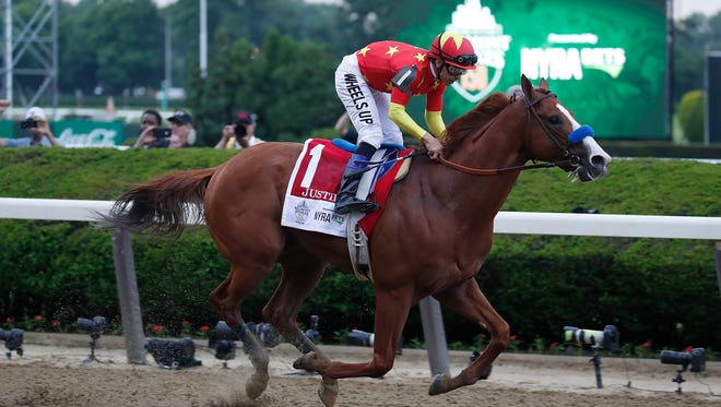 Mike Smith aboard Justify (1) wins the 150th Belmont Stakes at Belmont Park.