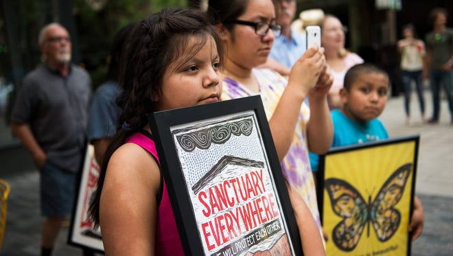 Selena Olivera, 10, attends a demonstration against family separation at the U.S./Mexico border at One City Plaza on Thursday, June 14, 2018.