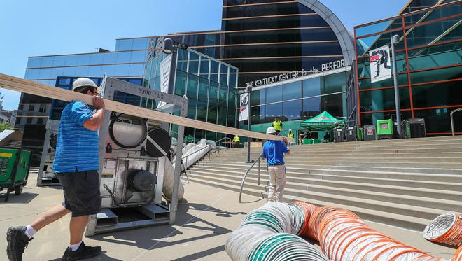 Crews begin repairs on the Kentucky Center for the Performing Arts on Friday afternoon after a mid-week fire during planned renovations to the building.  Most of the water damage was contained to the front lobby but much of the building still smells of smoke.June 15, 2018