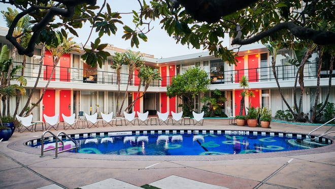 The Phoenix Hotel has a pool surrounded by palm trees. Retro motels are very chic these days.