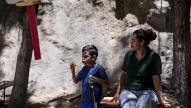 Miria Maradiaga, 40, of Honduras, plays with her son, Jesus, 5, on Thursday, June 21, 2018, at Casa Belen, a migrant shelter in Nogales, Sonora, Mexico. Currently, there are 56 families in Nogales waiting to apply for asylum.