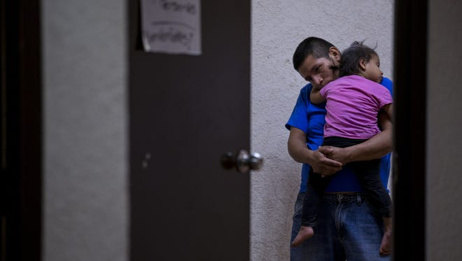 Lorenzo Chial, 26, of Guatemala, holds his daughter, Maria Esperanza, 2, on Thursday, June 21, 2018, at Casa Belen, a migrant shelter in Nogales, Sonora, Mexico. Currently, there are 56 families in Nogales waiting to apply for asylum.