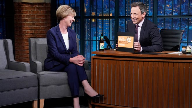 LATE NIGHT WITH SETH MEYERS -- Episode 701 -- Pictured: (l-r) Sen. Tammy Baldwin during an interview with host Seth Meyers on June 21, 2018.