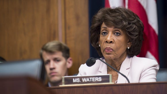 Ranking Member Maxine Waters, D-Calif., looks on as