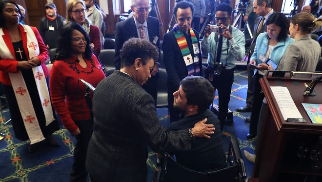 Rep. Barbara Lee (D-CA) (L) talks with Ady Barkan, who lives with Amyotrophic Lateral Sclerosis, following a rally against the GOP tax bill in the Rayburn Room at the U.S. Capitol December 19, 2017 in Washington, DC.
