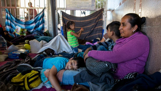 Guadalupe Arcos Avila, 34, of the state of Guerrero, sits with her son, Aldo Duvan, 4, on Wednesday, June 20, 2018, at the DeConcini Port of Entry in Nogales, Sonora, Mexico. She has been waiting for an asylum interview with U.S. immigration officials for nine days.