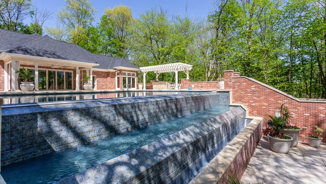 The house on toney Sunset Lane has five bedrooms and a pool house with pool.
