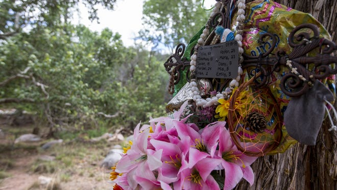 A memorial for the victims of a flash flood that swept through Ellison Creek on July 15, 2017, is pictured on July 14, 2018, near Payson.
