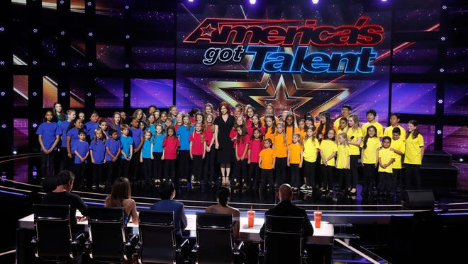 Voices of Hope children's choir director Sarah Grandpre joins her children's choir onstage after a performance of 'How Far I'll Go' on America's Got Talent July 19.