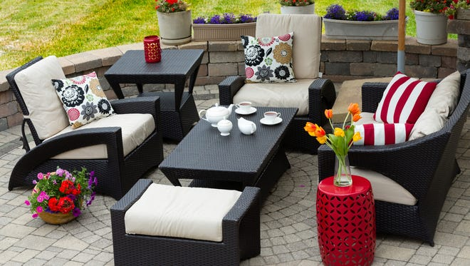 Proper care and cleaning can keep your patio furniture looking new for years to come. (Dreamstime)