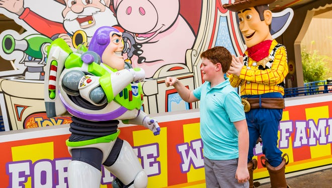 Beloved characters from Pixar Animation StudiosÕ Toy Story films, including Buzz Lightyear and Woody, await guests who visit Toy Story Land at DisneyÕs Hollywood Studios. The 11-acre land transports Walt Disney World guests into the adventurous outdoors of AndyÕs backyard, where they will feel like they are the size of a toy. (Matt Stroshane, photographer)