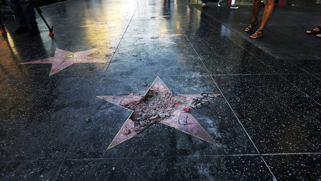 This July 25, 2018, file photo shows Donald Trump's vandalized star on the Hollywood Walk of Fame in Los Angeles.
