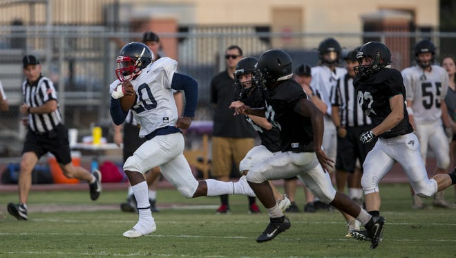 Centennial's Davon Fountain rushes during a scrimmage against Arcadia on Wednesday, Aug. 8, 2018, at Chandler High School in Chandler, Ariz.