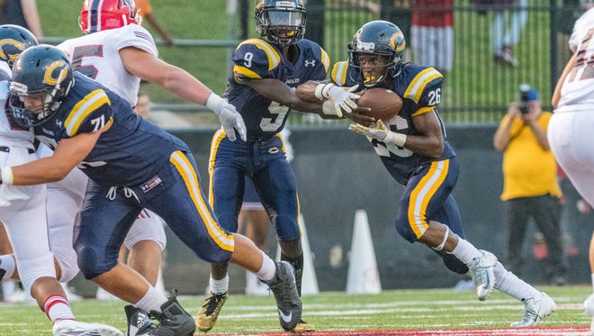 """Carencro senior Trejun Jones, pictured here taking a handoff during the Bears' jamboree against Notre Dame last month, produces music in his spare time, including producing a song that was featured in the Emmy-winning show """"Atlanta."""""""