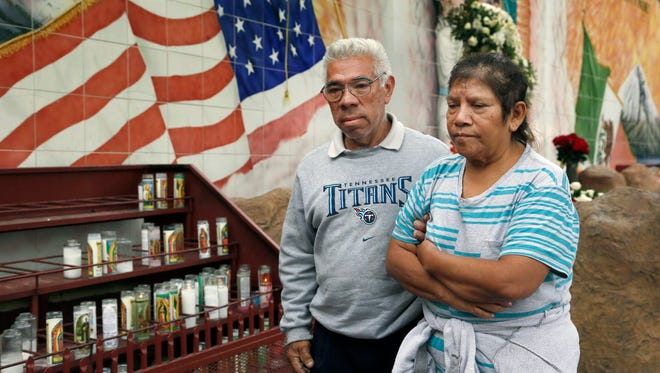 Los Angeles resident German Nova from El Salvador, walks with his wife Maria Fernandez, a U.S. citizen from Mexico after praying at Our Lady Queen of Angels La Placita in Los Angeles on Thursday. U.S. President Barack Obama is set to announce legal rights for up to five million people who are undocumented immigrants a move that would impact not only them, but also their families, communities and workplaces.