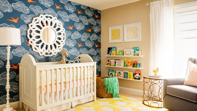 In this photo provided by J and J Design Group, bold pops of color and playful details make for nurseries and children's rooms that are stylish and sophisticated.  Scottsdale, Ariz. designers Joanna Gick and Jennifer O'Dowd use on-trend elements like imaginative wallpapers, painted vintage dressers, and unexpected elements with grown-up lighting, furniture pieces and accessories that add fun and flair. (John Woodcock/J and J Design Group via AP)