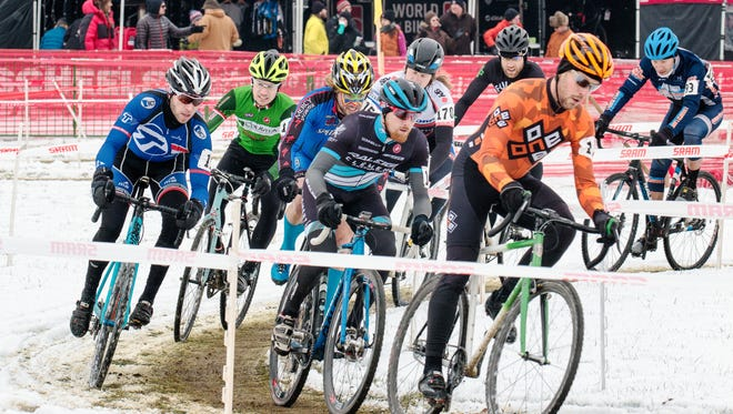 Competitors race around the course in the women's Cat 2, & 3, Single Speed and Men's Masters 55+ race during the annual Jingle Cross Cyclocross Race at the Johnson County Fairgrounds on Sunday, November 15, 2014.