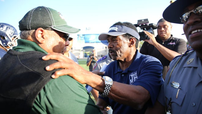 MVSU coach Rick Comegy, left, and JSU coach Harold Jackson, right, greet each other after the homecoming game.