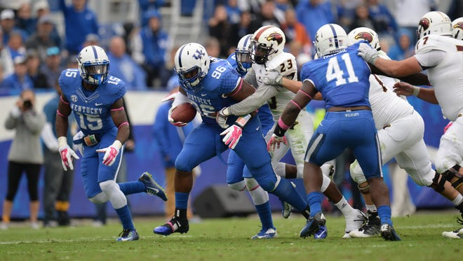 UK DT Regie Meant runs with the ball after recovering a fumble during the second half of the University of Kentucky Wildcats Football game against Louisiana-Monroe in Lexington, KY. Saturday, October 11, 2014.