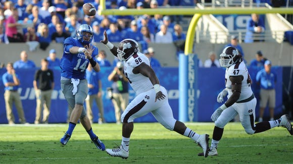 Kentucky quarterback Patrick Towles throws a pass in the first half against Mississippi State on Saturday