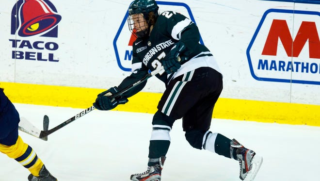 Michigan State Spartans forward Matt Berry (27) takes a shot during the game against the Michigan Wolverines at Yost Arena.