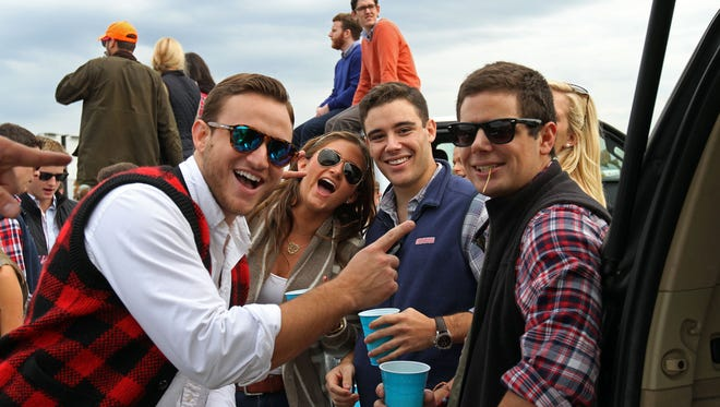 Attendees party on the infield of the track at the annual Far Hills Race Meeting that includes plenty of tailgating and horse racing, October 18 2014 Warren NJ. Photo by Kathy Johnson BRI 1019 Far Hills races