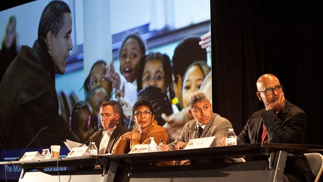 In this Jan. 13, 2015 file photo, from left, Chicago Park District Superintendent and CEO Michael, Kelly, Vice President Avis LaVelle and commissioners Juan Salgado and Tim King listen to citizens at a public hearing in Chicago about a University of Chicago proposal to build President Barack Obama's presidential library on public parkland.