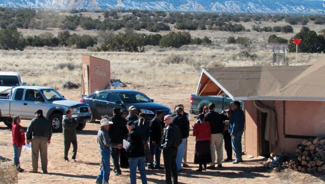 This Saturday, Jan. 25, 2015, photo, provided by Rep. Ann Kirkpatrick's office, shows tribal and federal officials visit Nahata' Dziil, Ariz.