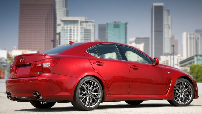 FILE - This undated picture made available by Toyota shows the 2011 Lexus IS F.  Toyota is recalling nearly 423,000 Lexus luxury brand cars in the U.S. to fix fuel leaks that can cause fires. The recalls affect the 2006 to 2011 GS, 2007 to 2010 LS and the 2006 to 2011 IS models. Toyota says the cars' fuel lines have nickel phosphate plating to protect against corrosion. Some lines could have been built with particles coming in contact with a gasket. That can cause the sealing property to deteriorate and trigger fuel leaks. Toyota says it's not aware of any fires or injuries caused by the problem.(AP Photo/Toyota)