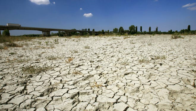 The dried up bed of the Po river, which flows eastward across northern Italy, from Monviso to the Adriatic Sea near Venice.