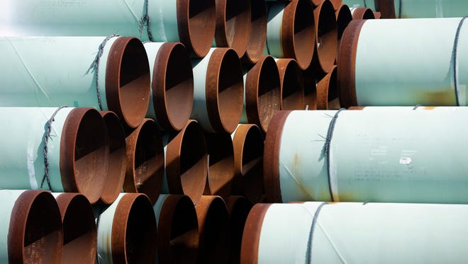Some of more than 350 miles of pipe awaiting shipment for the Keystone XL oil pipeline is stored at Welspun Tubular, in Little Rock, Ark., on Aug. 20, 2014.