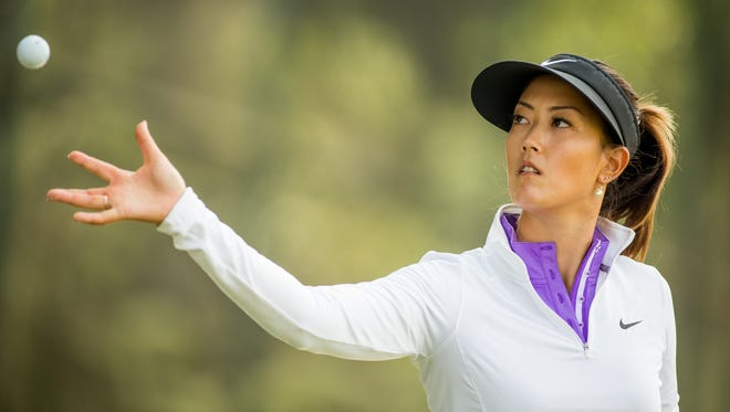 Michelle Wie is shown warming up up on the driving range prior to last week's Lorena Ochoa Invitational. Wie, who won the U.S. Women's Open, had a season that was marred by injuries.