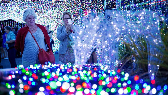 Over 1 million lights have been set up in Canberra, Australia, officially breaking the Guinness World Record for the largest LED image display. Visitors take photos on Nov. 29.