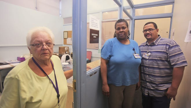 Connie Vitolo, a registered nurse, along with senior counselors Rosa Battle and Fred Pignataro are photographed at the medication dispensing window at St. Joseph's methadone clinic in Yonkers on Oct. 1.