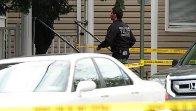 Officers from the Westchester County Forensics Investigation Unit process the scene Friday at 158 Stevens Ave. in Mount Vernon. An investigation is underway after police shot and wounded a man inside the multifamily home.