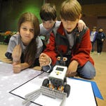 Bella Maiuiero, Conner Nicholson and Sutton Oathout test their robot during the Regional Autonomous Robotics Circuit competition Saturday at the Bossier Civic Center in Bossier City in 2014. Bella Maiuiero, Conner Nicholson and Sutton Oathout test their robot at the Regional Autonomous Robotic Circuit competition held Saturday at the Bossier Civic Center.  Stan Carpenter/The Times