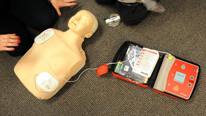 An automated external defibrillator, which is used during cardiac arrest, is tested on a mannequin.
