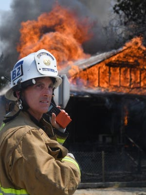 Battalion Chief Cary Wright directs firefighting operations at a fire in Taft August 18.